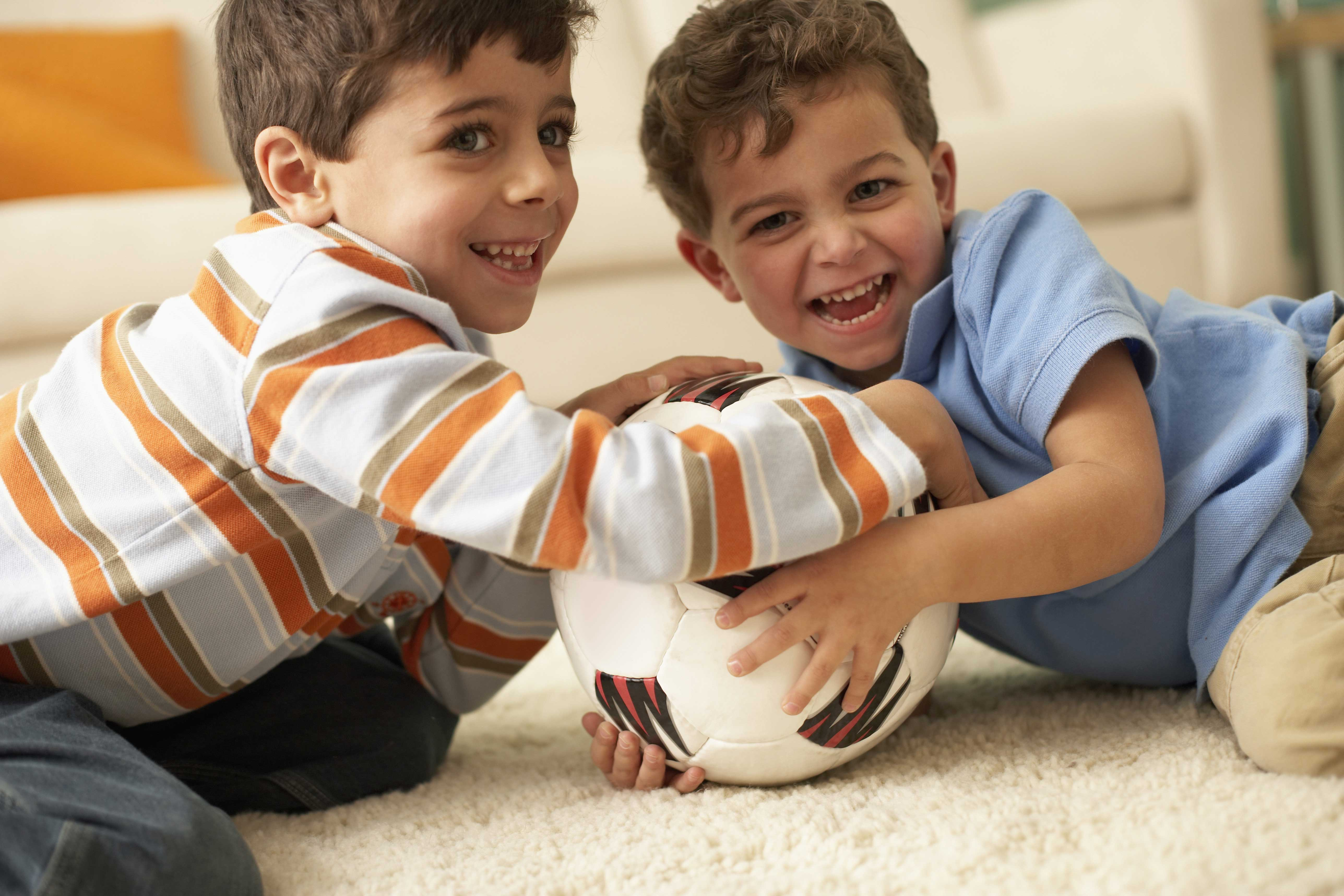 Boys Playing On Clean Carpet